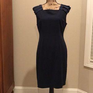 Elegant navy blue sheath cocktail dress.